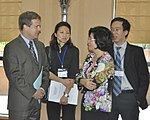 Acting Senior Deputy Assistant Administrator Jason Foley of USAID (left) and Ms. Phan Thi My Linh, Vice Minister of Vietnam's Ministry of Construction (right) (14117965911).jpg