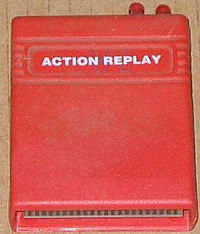 A large square software cartridge in a red case.