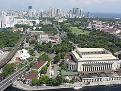 The skyline of Ermita with Manila Central Post Office and Intramuros in the foreground