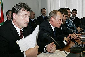 Ramzan Kadyrov - From left to right: President Alu Alkhanov, Russian President Vladimir Putin, and Kadyrov at the first session of the Chechen Parliament in December 2005.