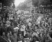 Allied military personnel celebrating the Japanese surrender in Paris.