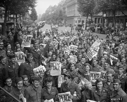 Allied personnel celebrate the Japanese surrender in Paris. American military personnel gather in Paris to celebrate the Japanese surrender.jpg