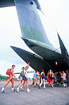 American students board a C-141B Starlifter aircraft as they are evacuated by U.S. military personnel during Operation Urgent Fury DF-ST-84-09821.jpg