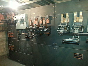 Electric switchboard - Antique electrical switchboard, operational at a US plant in 2014. It features open style breakers, mounted on slabs of slate stone insulator.