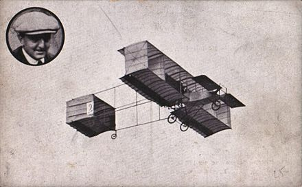 "1909 Voisin biplane, with ""curtains"" connecting the upper and lower wings Anvers Aviation Meeting in 1909. Rougier flying a Voisin biplane with a Gnome Omega engine.jpg"