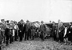 Arthur Butler and his Comper Swift aeroplane G-ABRE in field with crowd, 1931 (digital restoration).jpg