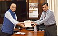 Arun Jaitley receiving the Report of the Committee to Review Offences under the Companies Act, 2013, from the Secretary, Ministry of Corporate Affairs, Shri Injeti Srinivas, in New Delhi.JPG