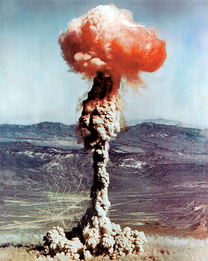 Effects of nuclear explosions - The 14 kiloton test shot Charlie of Operation Buster-Jangle at the Nevada Proving Grounds October 30, 1951. The red/orange color seen here in the cap of the mushroom cloud is largely due to the  fireball's intense heat in combination with the oxygen and nitrogen naturally found in air. Oxygen and nitrogen, though generally nonreactive toward each other, form NOx species when heated, specifically nitrogen dioxide, which is largely responsible for the  color. There was concern in the 1970-80s, later proven unfounded, on fireball NOx and ozone loss