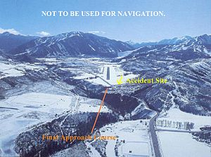 2001 Avjet Aspen crash - A daytime fair weather view of the approach to runway 15 at Aspen airport, depicting accident site of N303GA (NTSB report).