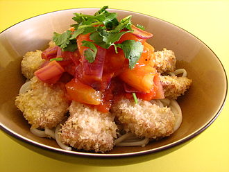 Bread crumbs - Baked panko crusted pork with pineapple sauce over udon
