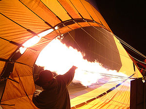 Hot air ballooning - Hot air balloon being inflated by its propane burners prior to a dawn launch.