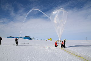 Halley Research Station - A balloon from NASA's BARREL program begins to rise over the brand new Halley VI Research Station, which had its grand opening in February 2013