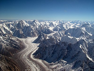 The Baltoro Glacier in Kashmir. At 62 kilometres (39 mi) in length, it is one of the longest alpine glaciers on earth. Baltoro glacier from air.jpg
