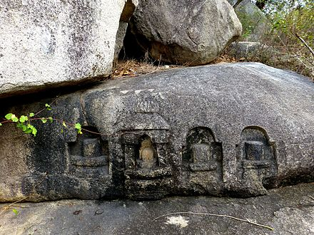 Barabar Caves - Lingas carved in Rock (9227556966).jpg