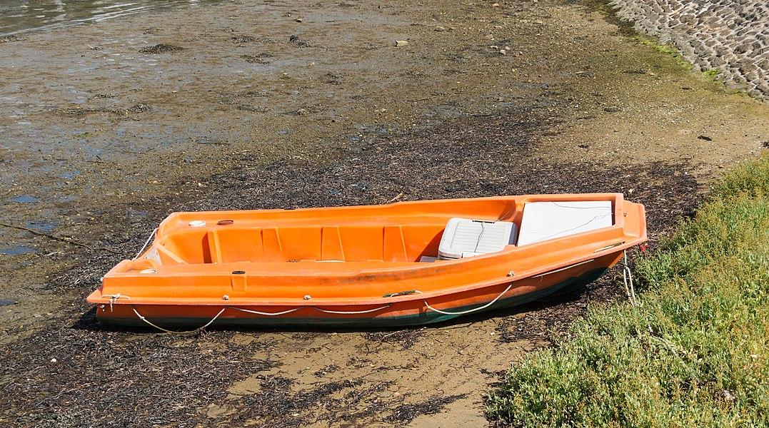 An orange boat, Île aux Moines, Morbihan, France.