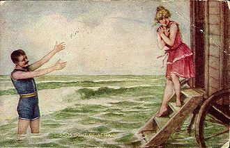 Swimsuit - Man and woman in swimsuits, c.1910; she is exiting a bathing machine