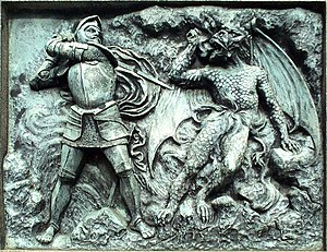 English: One of the the bas-reliefs on the bas...