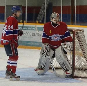 Great Lakes Junior C Hockey League - Belle River goalie watches puck behind his net during 2013-14 season.