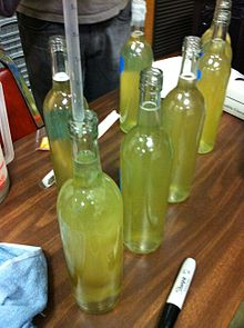 Bentonite sample addition in bottle.JPG