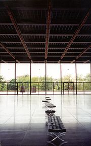 This interior view of the Neue Nationalgalerie's ground floor shows the play of light off the reflective floor, as well as the animated red LCD tracks on the ceiling.