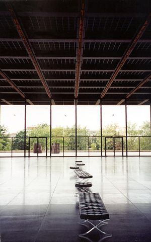 Neue Nationalgalerie - This interior view of the Neue Nationalgalerie's ground floor shows the play of light off the reflective floor, as well as the animated red LCD tracks on the ceiling.
