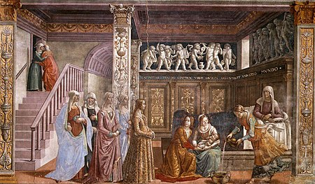 Fresco. St Anne rests in bed, in a richly decorated Renaissance room. Two women hold the newborn baby Mary, while a third prepares a tub to bath her. A group of richly-dressed young women are visiting. On the left is a staircase with two people embracing near an upper door.