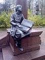 Blind reading girl near the Grot stela monument.jpg
