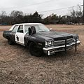 Bluesmobile in the field with briefcase.jpg
