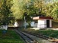 Bridge, railway tracks and worker cabin in park Globus; Dnipro, Ukraine; 16.10.19.jpg