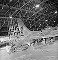 British civilian technicians repair a B17 Flying Fortress bomber in 1942. D11800.jpg