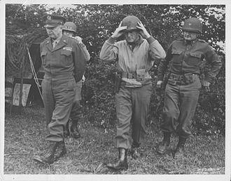 Edward H. Brooks - Major General Brooks walking with General Eisenhower, Lieutenant General Bradley and Colonel Palmer.