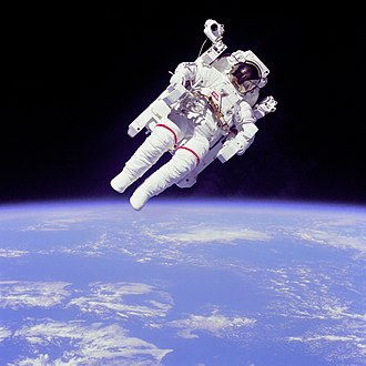 "Extravehicular activity - Untethered U.S. astronaut Bruce McCandless uses a manned maneuvering unit. Photo taken by Robert ""Hoot"" Gibson"