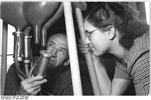 Dairy farming - Demonstration of a new Soviet milker device. East Germany, 1952