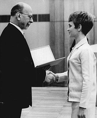 Patriotic Order of Merit - Party chief Walter Ulbricht awarding Karin Janz a silver Patriotic Order of Merit in 1968