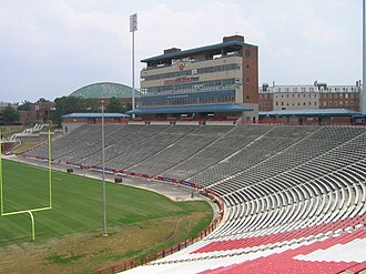 Maryland Terrapins football - A view of Maryland Stadium showing the old (since replaced) Tyser Tower suites (center). Basketball arena Cole Field House is in the distance (left).