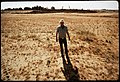 CLYDE KEPLEY, OWNER OF SANITARY LAND FILL, STANDS ON HIS 13 ACRE FINISHED AREA, WHICH HAS FILL - NARA - 542548.jpg