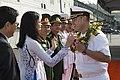 Capt. Stanfield Chien receives a wreath from Da Nang locals. (34622961481).jpg