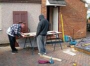 Carpenters repair a door arp