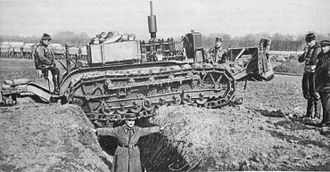 Schneider CA1 - Final caterpillar test, on 21 February 1916, before the mass order of the Schneider CA1 tank on the 25th. The eight-wheeled vehicle is shown. The man spanning the trench with his arms is Fouché.