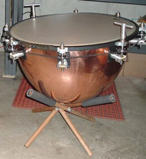 Timpani - On chain timpani, a chain links the tension rods so a master handle can be used to turn them all at once.