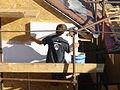 Chantier maison bois pose panneaux facade.jpg