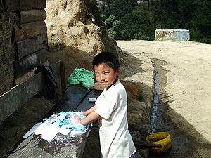 Child at work in Sandakphu, doing some houshol...