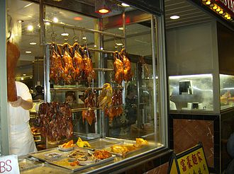 Canadian Chinese cuisine - Roasted geese are put on display in Toronto's Old Chinatown. Roast goose is a popular Cantonese dish that is also served by Canadian Chinese restaurateurs.