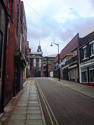 Burslem - Clayhanger Street, Burslem, by the side of the Wedgwood Institute showing the clock tower of Burslem Town Hall in the background, May 2008
