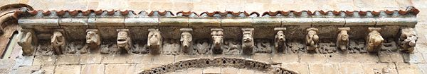 Romanesque corbel table featuring erotic scenes at Colegiata de Cervatos, near Santander, Spain Colegiata de Cervatos - Canecillos sobre la portada.jpg
