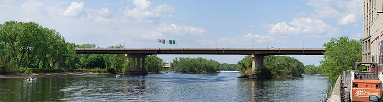 Looking upstream along the Hudson River at the Collar City Bridge in Troy, New York