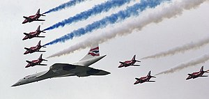 Aerospace industry in the United Kingdom - A parade flight comprising an Aérospatiale-BAC Concorde and BAE Hawks of the Red Arrows aerobatics display team for the Queen's Golden Jubilee.