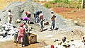 Construction site workers loading water, sand, ballast and cememt into a concrete mixer in Embu, Kenya 4a.jpg