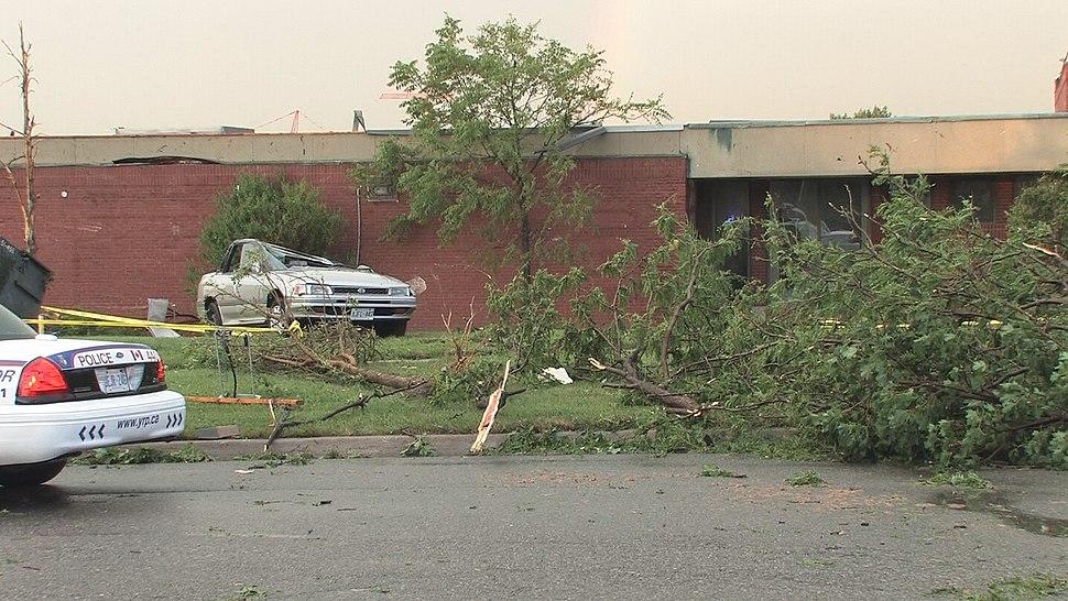 Crushed car tornado aftermath on the lawn of a school in Woodbridge