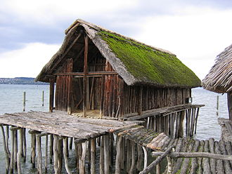Prehistoric pile dwellings around the Alps - Reconstruction of a pile house at the Pfahlbau Museum Unteruhldingen on Lake Constance in Germany